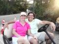 _Merri  Andy in golf cart parking lot 5-8-12