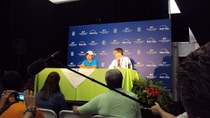 Jason Day in the Media Center with PGA TOUR Media Official John Bush answering questions after winning for the first time.