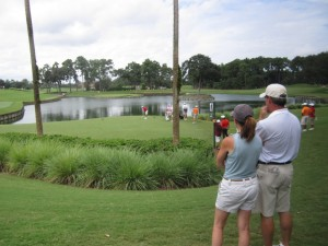 Mary Ellen and Bob Hall watch their son Galvin tee off on the famous 17th at TPC Sawgrass.
