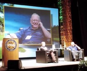Host Matt Adams interviewing Billy Casper on the main stage at the 2012 PGA Show.