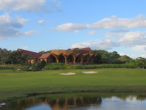 The clubhouse with the 18th fairway in front. Green to the right protected by the lake.