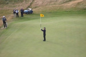 In the grandest of sporting gestures, Tom Watson raising the flagstick on No. 15 to enable Steve Marino to know the location of the hole.