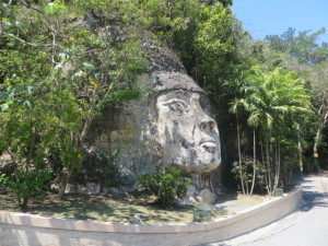 The Taino Indian face carved in the rock wall makes the turn to Royal Isabela. You are getting close and can feel her presence.