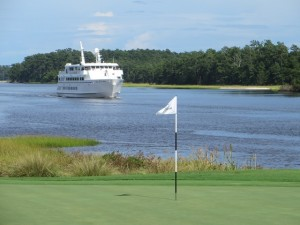 Cruise ship coming by the 18th green at Glen Dornoch.