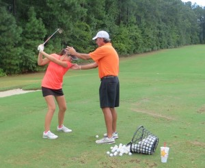Instructor Hugh Royer, III working with junior golfer Haley Cleary.