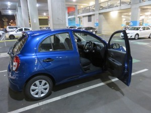 My little Nissan Micra, standard shift, in Berlin Blue, with the steering wheel on the wrong side! Left, Left, Left!