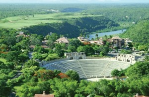 Aerial view of Altos de Chavon with Amphitheater in the foreground and Dye Fore golf course above the river. PHOTO CREDIT: Casa de Campo