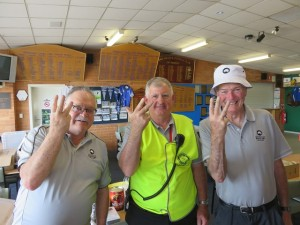 Three of my volunteer friends- Barry, Doug & Andy (Pam went home early) signaling Day 3 of the Masters!