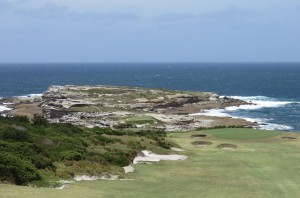 The 5th green in the foreground and the island rock outcrop which is a part of the Cape Banks Aquatic Reserve.