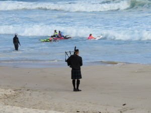 Bagpiper on Bondi Beach. We happened to come while there was a solemn voyage to take a loved one's ashes to sea and spread them.