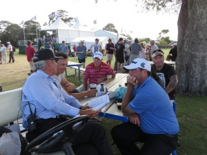 Boo Weekley hanging out with Stephen Bowditch and having a friendly chat with Rules Official No. 5.