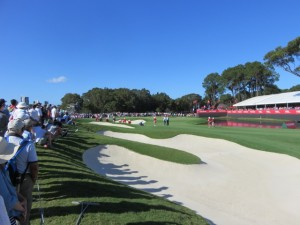 Galleries were large again on Friday, this one encircling Rory on the 18th green.