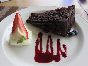 Mississippi mud cake, berry coulis, and fresh cream.