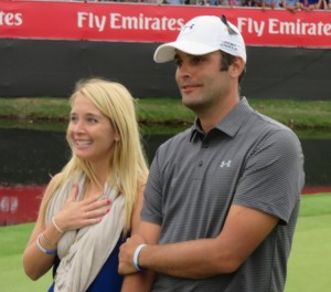 Part of Team Jordan, caddie Michael Greller and his wife Ellie react to the heartfelt win during the Awards Ceremony.