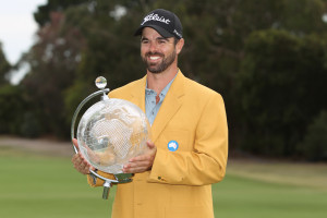 Nick Cullen, in the Gold Jacket, with the 2014 Masters trophy!   Photo Credit: SMP Images.
