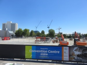 A new convention center is planned in the foreground as beyond there are cranes in place rebuilding Christchurch, 'the Newest City on Earth.'
