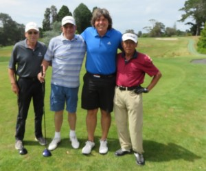 With my golfing foursome at Titirangi Golf Club- Bill Anderson (L), Lou Travaguia (White striped shirt) and the mysterious Mr. Yang with whom I partnered!
