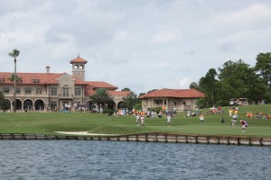 Galvin Hall (in red shirt) putting on the 18th green at TPC Sawgrass en route to the Jr. PLAYERS Championship (Photo courtesy of Jacqueline Davis)