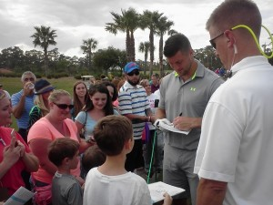 Tim Tebow giving autographs after the Celebrity Golf Classic.