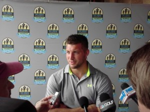 Tim Tebow fielding media questions, many about his future NFL playing career.