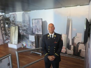 Retired NYFD Battalion Commander Jack Oehm in front of the fallen Towers and the risen Freedom Tower.