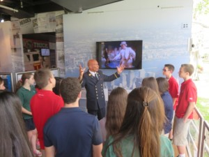 Retired NYFD Battalion Commander Jack Oehm giving a tour of the September 11 traveling exhibit to Mrs. Mulligan's eighth grade class.