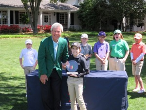 Effie Perakis, Girls 7-8 Champion with Masters Champion Ben Crenshaw. Effie made a 30-foot putt on the 18th green to win! She jumped higher than Phil Mickelson when he won!