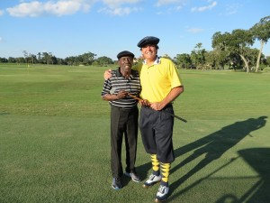 With Calvin Peete after he first hit a hickory-shafted golf club. You can tell how excited he was by how he is holding the hickory club in this picture!