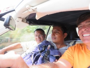 Driving along with my buddies Jesus the teacher (L) and Roland (R) the student and cologne salesman.