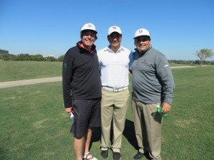 With Cougar golfer Roman Robledo and his uncle Rene Rangel, CEO of Sterling Golf.