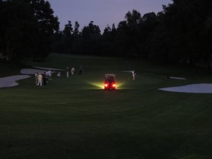Using a golf cart to light the 18th green, these guys take their golf seriously!