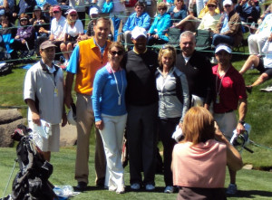 Tiger Woods posing with his pro-am group on Wednesday on the 18th green.