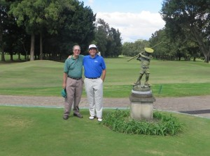 With Pepe Rolz near the Little Golfer Boy statue behind the 18th green at the Mayan Golf Club.