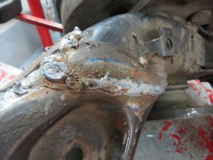 Closeup of the weld on Torch's boot... the axle is connected to the boot which is connected to the wheel, albeit a bit differently now.