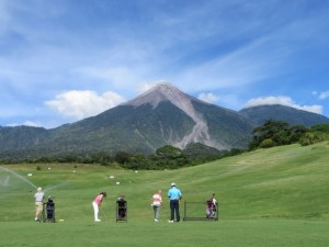Mario teaching a class on the practice range in full view of Volcano Fuego, the golf course's namesake.