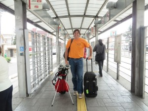 Traveling light, backpack, golf clubs and roller bag. Taking the Metro Bus to go get Torch!