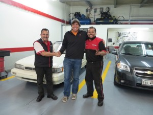 Congratulations to manager Fernando (L) and the mechanic (R) who cared for Torch and put her back on the Road to Rio!