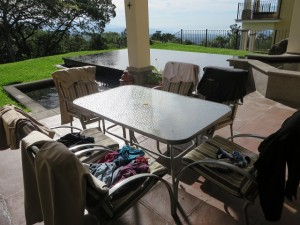 Laundry Day at La Reunion, wash in the bathroom sink, dry on the patio, onward to Rio!