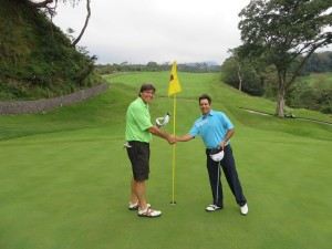 Finishing a remarkable round with Mario on the 18th green of Fuego Maya!