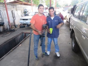Mechanic Virgil Martinez & his assistant with Torch's Strut & Spring assembly.