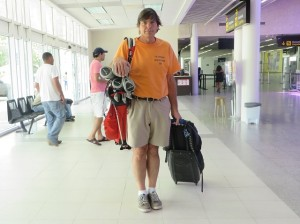 "Traveling light without Torch—roller bag, backpack & golf clubs—always wearing my Corey shirt for 'Safety for All Travelers."" as Dad would always say."