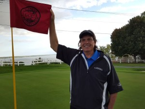 On the 9th with the customary flag unfurled position photo opp... Seneca Lake right there too!