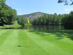 The 166-yard par-3 8th hole has a near island green in Lake Hampton and a gorgeous view of Rock Mountain.