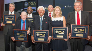 Lee Trevino (center) was joined by (front row) George Hannon, Tracey Stewart and Ray Cutright, and (back row) Thomas Bolt, Charles Sifford Jr. and Michael Doctor during the 2015 PGA of America Hall of Fame Induction Ceremony.   Photo Credit: Montana Pritchard/The PGA of America