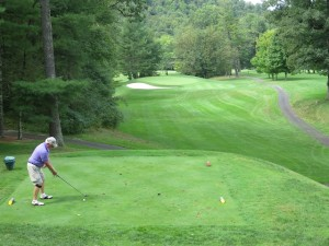 A Keene Golfer & Historian teeing off 'Carry On,' the 210-yard par 3 5th hole at the Cascades.