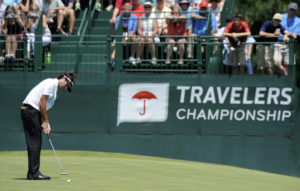 Bubba Watson watches his putt on the eighth green during the second round of the 2013 Travelers Championship. Photo Credit: AP Photo/Fred Beckham