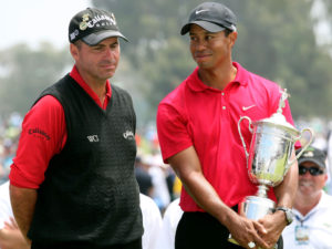 US Open Champion Tiger Woods with the trophy along with Rocco Mediate who was one stroke ahead on the tee at the last and lost with a bogey on the first sudden-death playoff hole after Tiger birdied the qq8th to tie. Dramatic for sure!