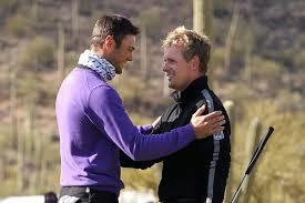 Martin Kaymer congratulates Luke Donald on his WGC - Accenture Match Play victory.   Photo Credit: European Tour