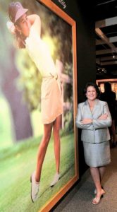 "World Golf Hall of Fame member Nancy Lopez poses in front of her mural leading her 'Personality, Pride, Passion"" exhibit. Photo Credit: St. Augustine Record"