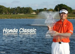 Yang celebrates with the trophy after winning The Honda Classic at PGA National Resort and Spa.   Photo Credit: Getty Images